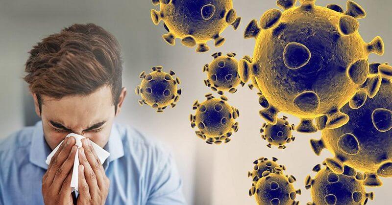 Virus Corona có thể lây nhiễm qua việc ho, hắt hơi